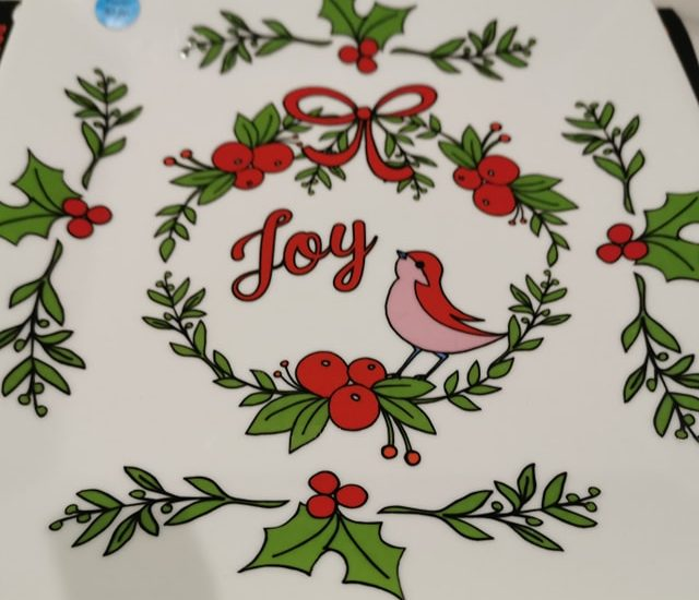 Christmas plate with Joy written on it