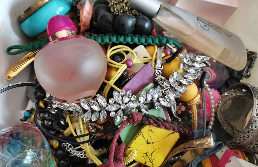 A collection of jewllery and perfume
