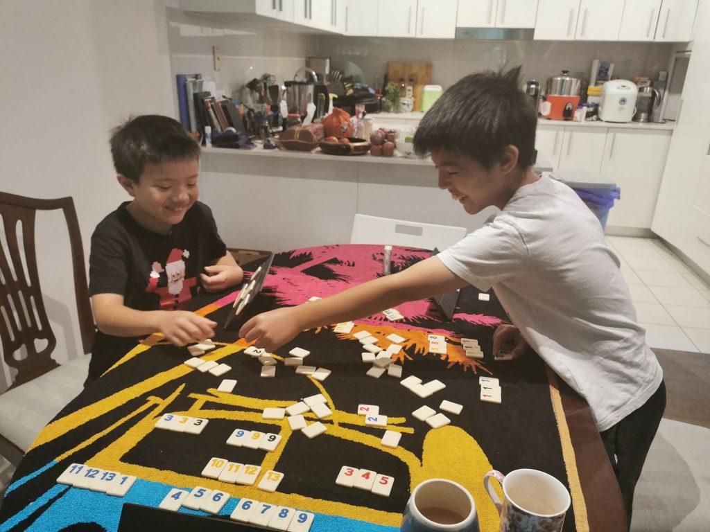 My boys playing Rummy